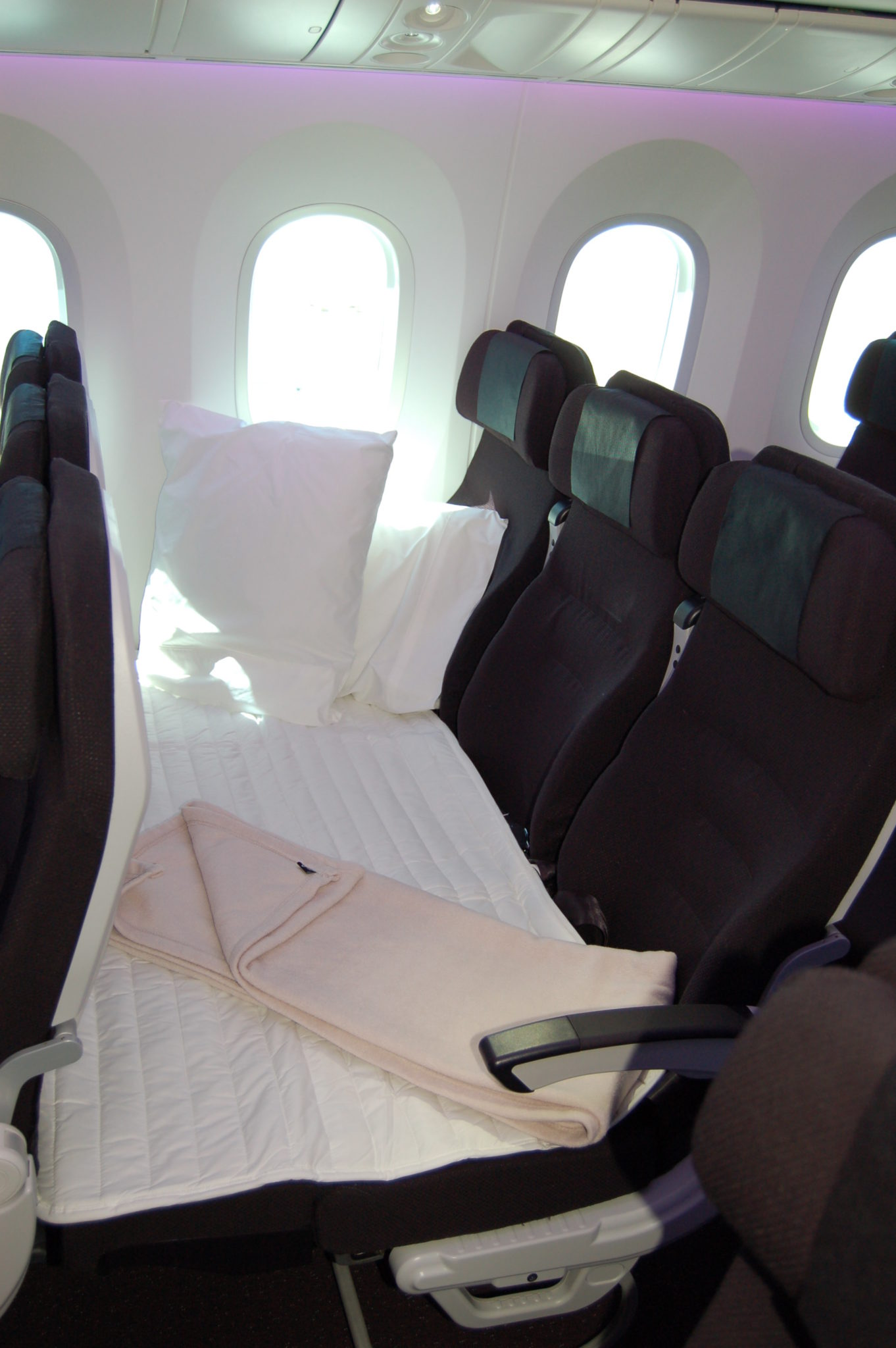 Air New Zealand offers an option in coach to buy all three seats, which permits a bed to be created. Photo by Scott Hamilton.