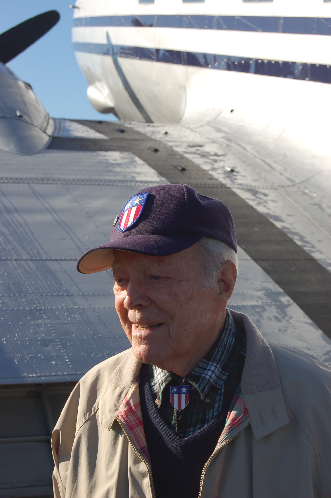 Peter Goutier, 100, is one of only two living members of China National Aviation Corp's pilot group from WW II. Behind him is probably the only surviving Douglas C-47/DC-3 from CNAC. Photo by Scott Hamilton