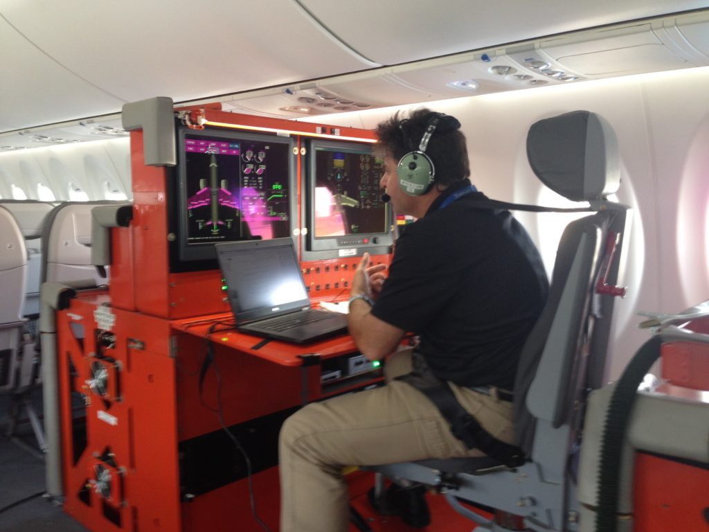 anthony-at-his-test-station-during-flight